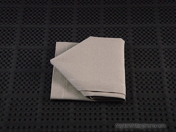 Cathedral style napkin folding step 6